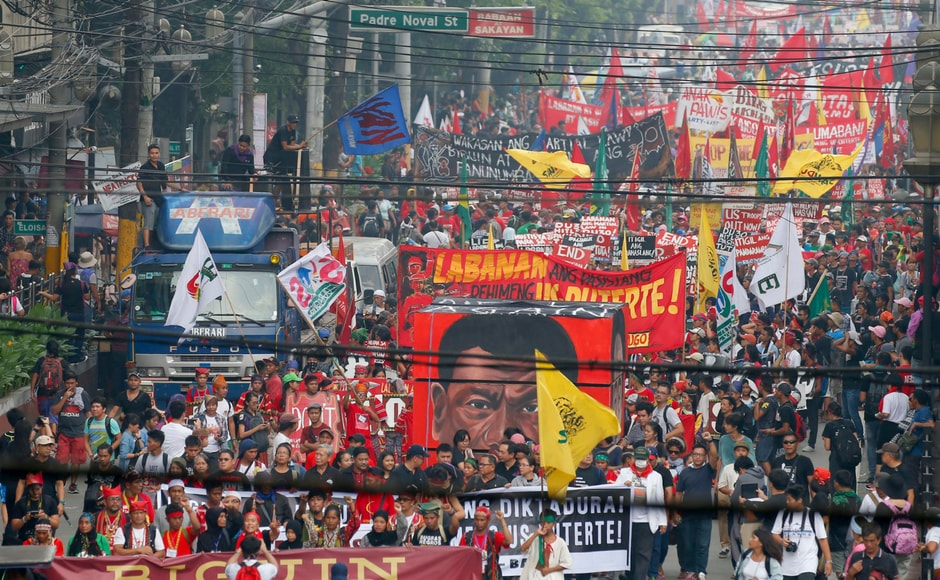 Thousands of protesters are marking the anniversary of the 1972 martial law declaration by late Philippine dictator Ferdinand Marcos with an outcry against what they say is the current president's authoritarian tendencies and his brutal crackdown on illegal drugs. AP