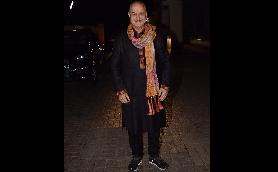Anupam Kher was dressed in a black kurta pyjama, with a multi-coloured dupatta.