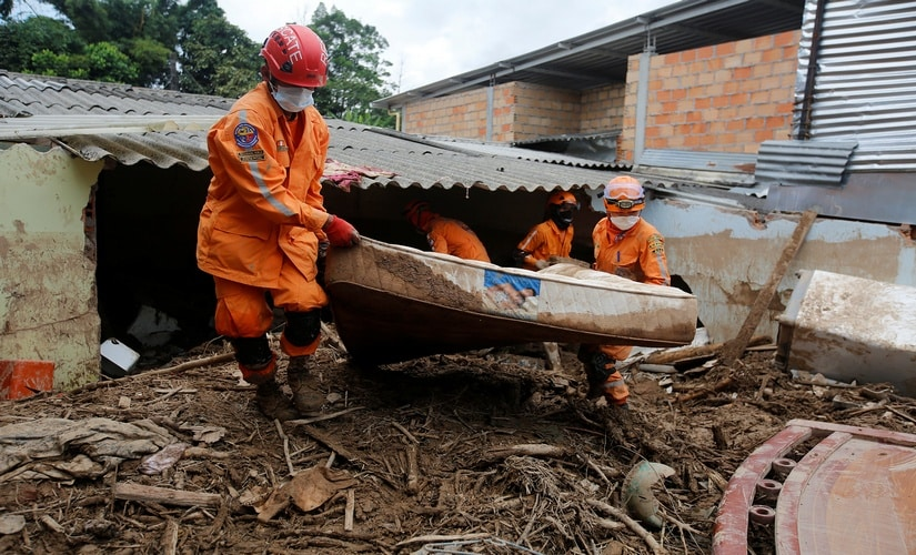 Rescue workers looking for bodies after the landslide in Colombia. Reuters