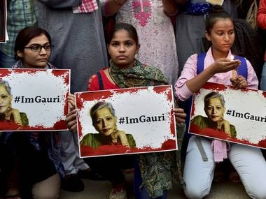 People take part in a candle light vigil at India Gate in New Delhi on Wednesday against killing of journalist Gauri Lankesh. PTI