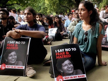 Demonstrators hold placards with the picture of Gauri Lankesh. PTI