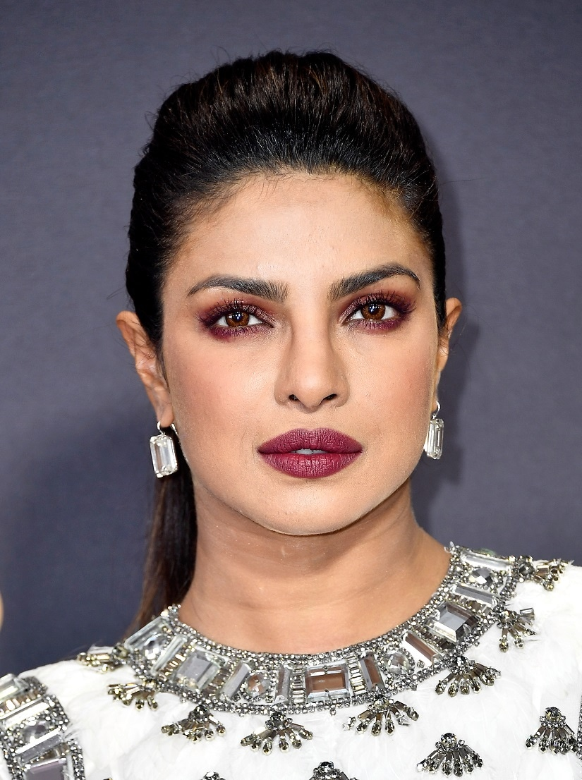 Priyanka Chopra's fierce make-up, sporting berry lips and eyes. Image from Getty Images.