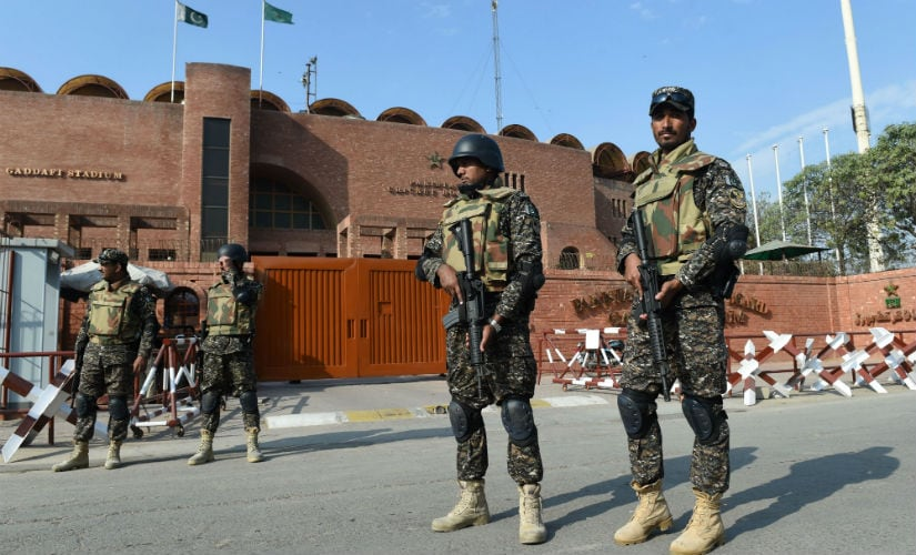 Pakistani soldiers patrol outside the Gaddafi Stadium in Lahore, ahead of the final cricket match of the PSL. AFP