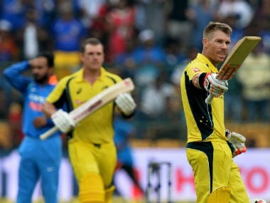 Australia's David Warner (R) celebrates his century while his partner Aaron Finch looks on against India in teh 4th ODI in Bengaluru. AFP