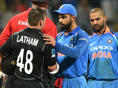 Virat Kohli (C) greets Tom Latham after New Zealand won the first ODI against India. AFP