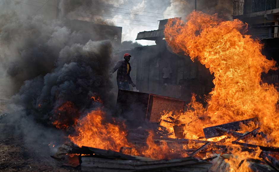 Kenya delays poll in opposition strongholds as clashes continue between police and protesters