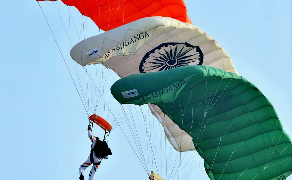 Members of Akash Ganga Sky diving team display their skill during the parade at Hindon Air Force base in Ghaziabad. PTI