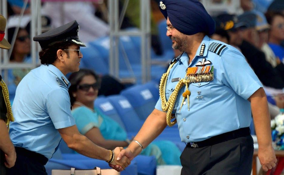 Captain of IAF, Sachin Tendulkar is greeted by Air Chief Marshal BS Dhanoa during the 85th Air Force Day parade on Sunday. PTI