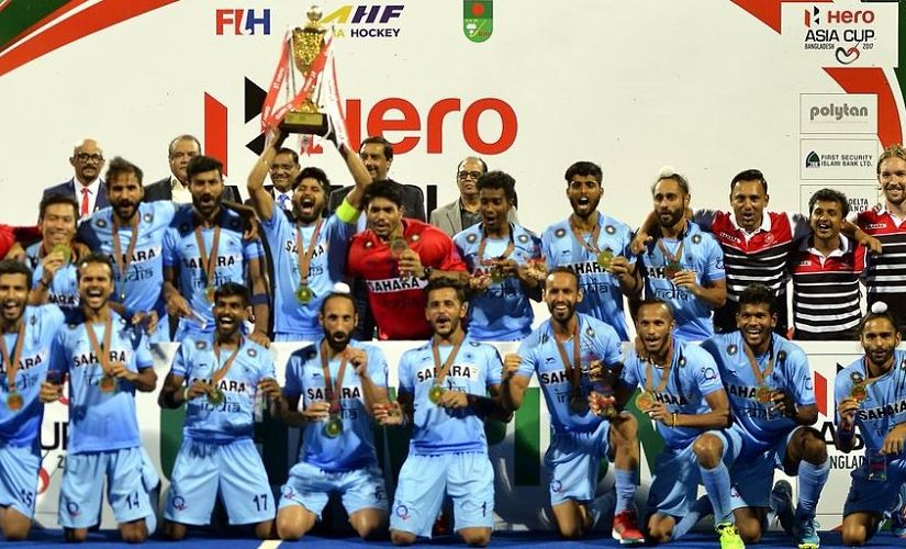 India's hockey team celebrating their Asia Cup victory.