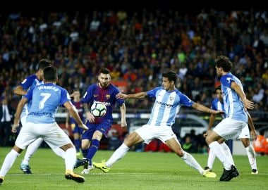 La Liga: Barcelona stride past Malaga to consolidate top spot amidst Catalan chaos; Valencia thrash Sevilla