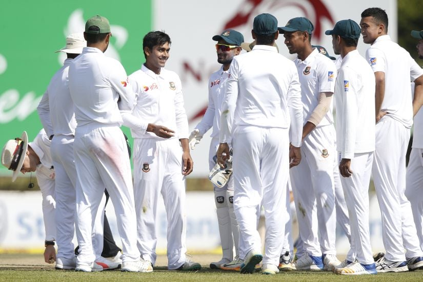Bangladesh bowler Mehidy Hasan along with teammates during the first Test match against South Africa. AFP