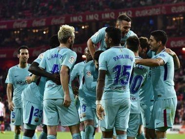 FC Barcelona's Paulinho, center, celebrates his goal with teammates. AP