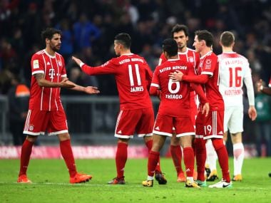 Bayern Munich's James Rodriguez, Javi Martinez and teammates celebrate their win over RB Leipzig. Reuters