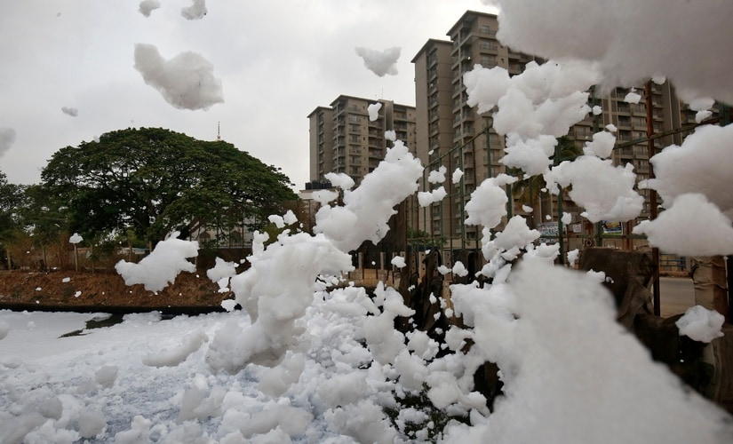 Toxic froth from the polluted Bellandur Lake is blown into the air by wind in Bengaluru, India, Image: Reuters