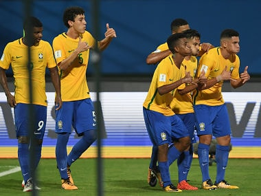 Marcos Antonio of Brazil celebrates with team mates after scoring against Honduras. Getty