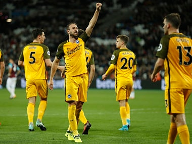 Brighton's Glenn Murray , center, celebrates after scoring his side's third goal during the match against Brighton and Hove Albion. AP