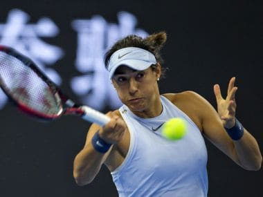 Caroline Garcia of France returns a shot to Elina Svitolina of Ukraine during a women's singles quarterfinal match in the China Open tennis tournament held at the Diamond Court in Beijing, China, Friday, Oct. 6, 2017. (AP Photo/Ng Han Guan)