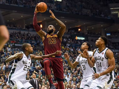 Cleveland Cavaliers forward LeBron James shoots the ball defended by Milwaukee Bucks. Reuters