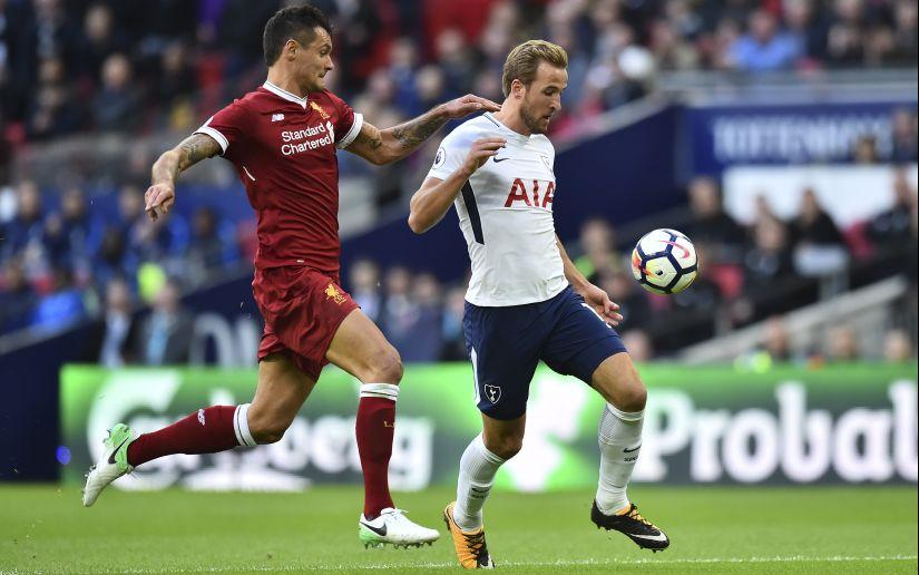 Tottenham Hotspur's Harry Kane (R) vies with Liverpool's Dejan Lovren during their Premier League match. AFP