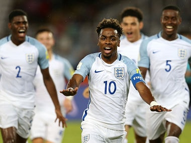 England's Angel Gomes celebrates after scoring a stunning freekick against Chile. Getty