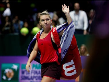 Simona Halep waves goodbye to the crowd after her group stage defeat against Elina Svitolina. Reuters