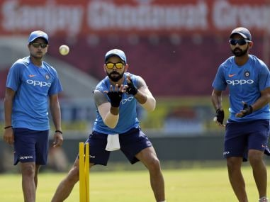 Indian captain Virat Kohli with teammates during a practice session in Nagpur. AP