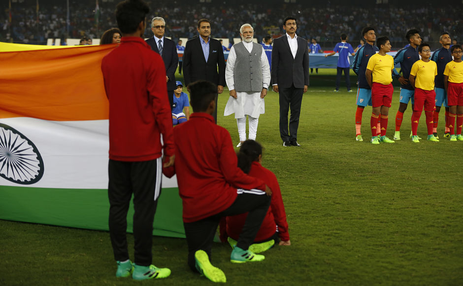 Indian Prime Minister Narendra Modi, in white, stands with other officials for the national anthem before the start of the FIFA U-17 World Cup match between India and the United States. AP