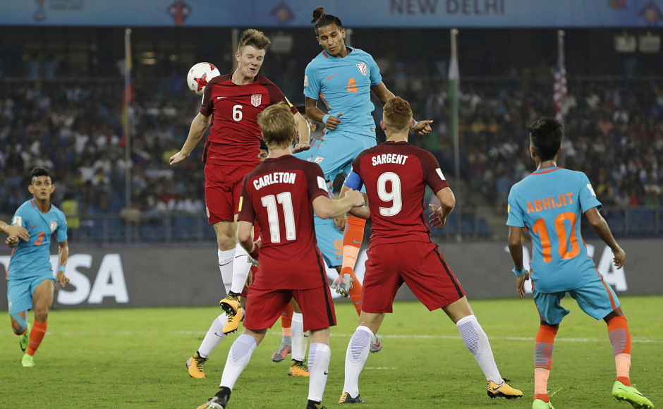 US player Chris Durkin, left, and India's Anwar Ali, right, jump for the ball during their FIFA U-17 World Cup match. India put up a spirited show in front of vociferous New Delhi fans. However, they lost to United States in the opening encounter. AP