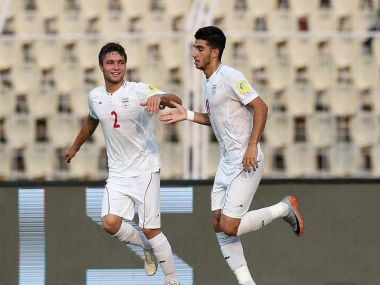 Iran's Mohammad Sharifi celebrates scoring the opening goal against Mexico. Getty