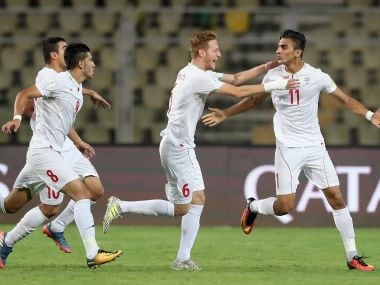 Iran's Younes Delfi celebrates with team mates after scoring his team's first goal against Germany in their Group C fixture. Getty