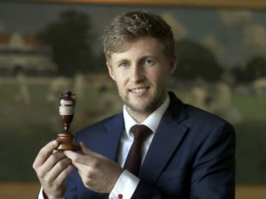 Joe Root poses with Ashes urn before departing to Australia with the England team. Reuters