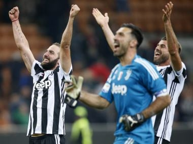 Juventus' Gonzalo Higuain, left, celebrates their win over AC Milan with teammates. AP
