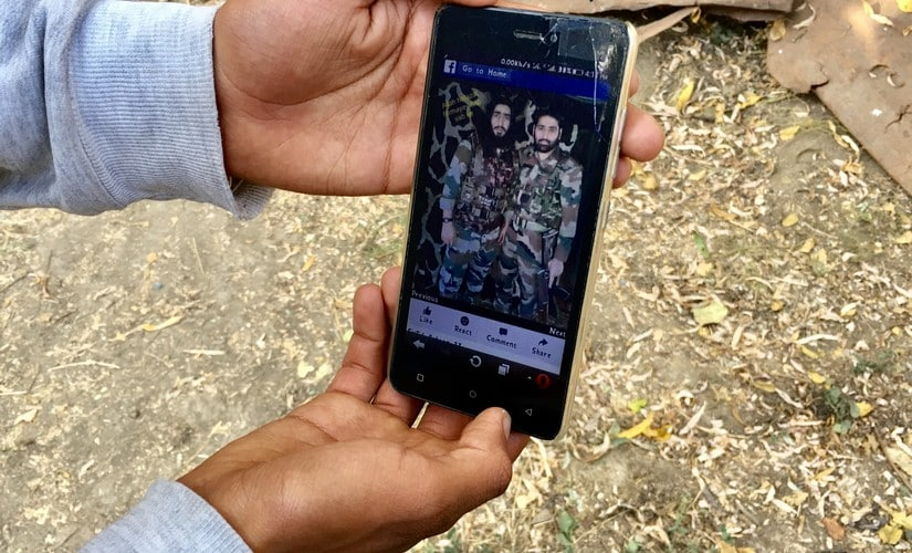 A teenager shows a picture of Falahi along with another militant, on his mobile phone. Sameer Yasir/Firstpost