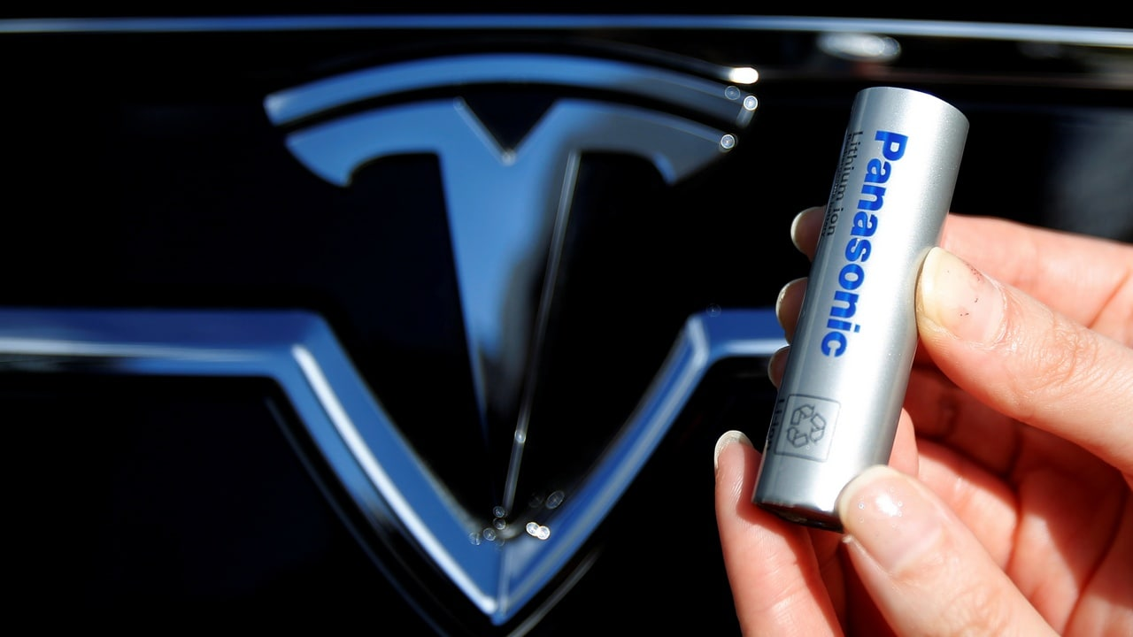 A Panasonic Corp's lithium-ion battery, which is part of Tesla Motor Inc's Model S and Model X battery packs, is pictured with the Tesla Motors logo during a photo opportunity at the Panasonic Center in Tokyo, Japan. Reuters