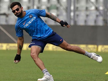 Indian captain Virat Kohli warms up during a practice session ahead of the first ODI against New Zealand. AP