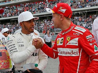 Mercedes driver Lewis Hamilton is congratulated by Ferrari driver Sebastian Vettel. AP