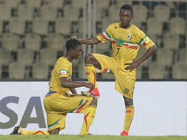 Fode Konate (L) of Mali celebrates with team mate Hadji Drame scoring his team's third goal against Iraq. Getty