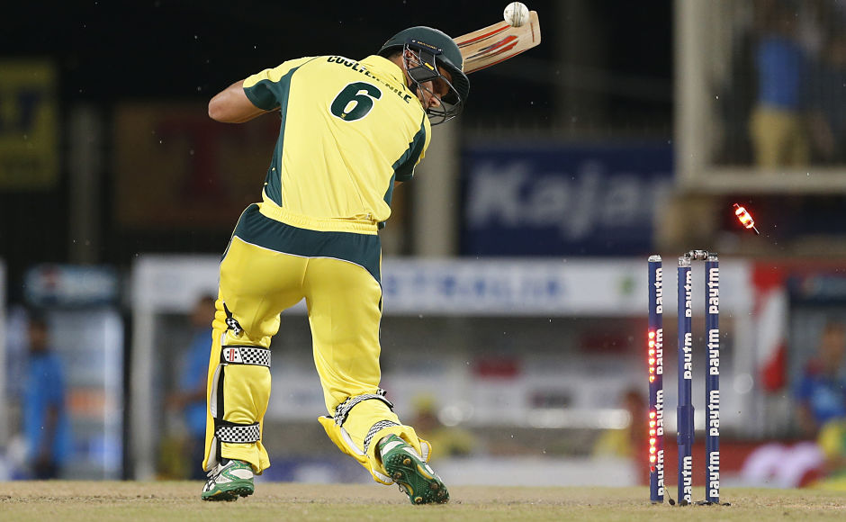 Nathan Coulter-Nile sees his furniture get rearranged by Jasprit Bumrah. Sunday was the first time that Australia lost six wickets in the form of 'bowled' in a T20I match. AP