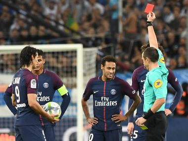 Referee Ruddy Buquet (R) shows a red card to PSG's Neymar (C) during their match against Marseille. AFP