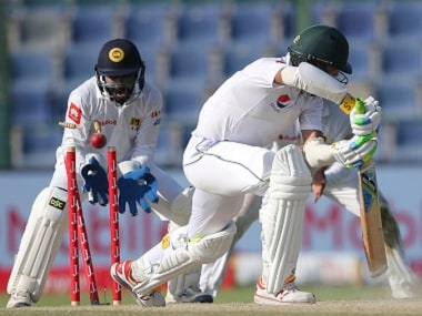 Mohammad Amir is bowled by Rangana Herath during the fifth day of the first Test. AP