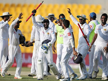 Sri Lanka players celebrate after they beat Pakistan during their fifth day at First Test cricket match in Abu Dhabi, United Arab Emirates, Monday, Oct. 2, 2017. (AP Photo/Kamran Jebreili)