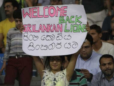 A fans holds a placard at the Gaddafi Stadium in Lahore during the 3rd T20I between Pakistan and Sri Lanka. AP