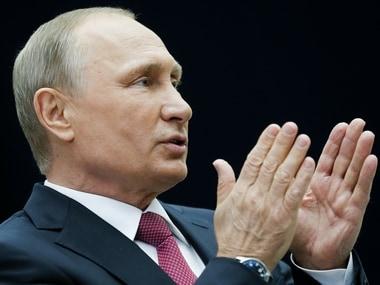 Vladimir Putin urges law agencies to take tough action against internet extremism