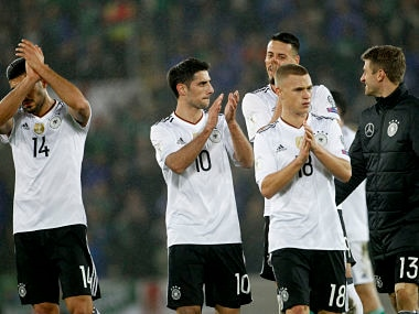 Germany's, from left, Emre Can, Lars Stindl, Joshua Kimmich and Thomas Mueller applaud their supporters after the World Cup Group C qualifying soccer match between Northern Ireland and Germany at Windsor Park in Belfast, Northern Ireland, Thursday, Oct. 5, 2017. (AP Photo/Peter Morrison)