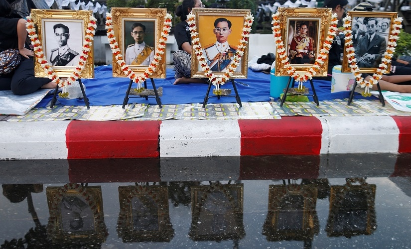 Pictures of late King Bhumibol Adulyadej are seen in Bangkok, Thailand. Reuters