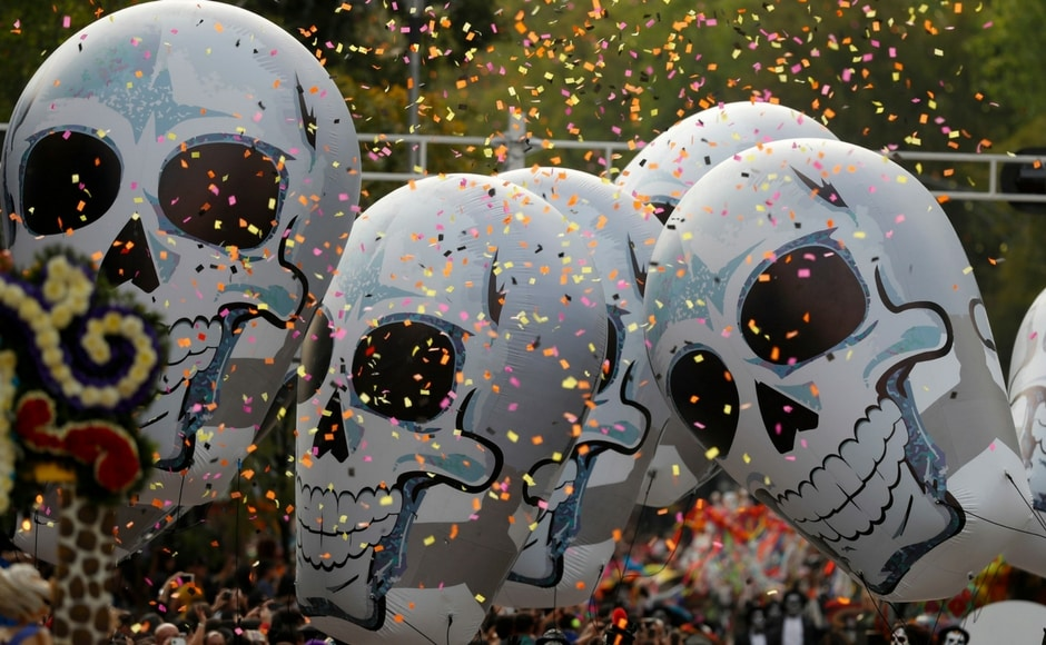 Mexico City's central Zocalo plaza was filled by the papier mache dead, skeletal Catrina figures and candle-covered shrines as hundreds gathered to honour the 228 capital residents killed by 19 September earthquake. AP