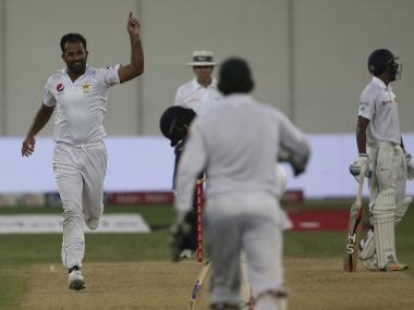 Pakistan's Wahab Riaz, left, celebrates after he dismissed Sri Lanka's batsman Dimuth Karunaratne during their third day at Second Test cricket match against in Dubai, United Arab Emirates, Sunday, Oct. 8, 2017. (AP Photo/Kamran Jebreili)