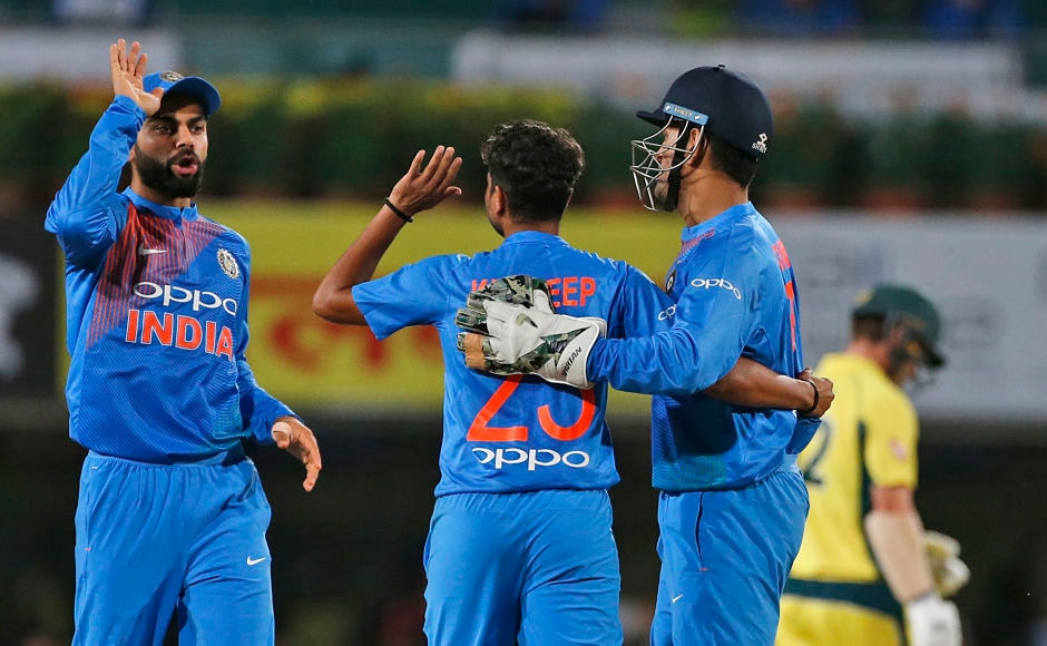 India captain Virat Kohli and wicketkeeper MS Dhoni congratulate Kuldeep Yadav, after he outwitted Aaron Finch and castled him. AP