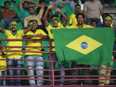 Brazil fans in Kochi celebrate at the end of the U-17 World Cup match between Brazil and Honduras. Getty Images