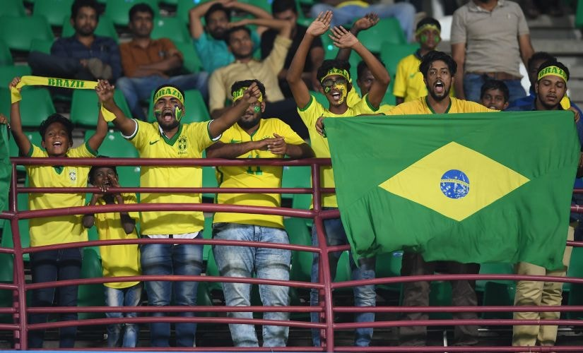 Brazil fans celebrate at the end of their team's FIFA U-17 World Cup Round of 16 win over Honduras in Kochi. Getty Images